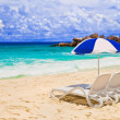 Chairs and umbrella at tropical beach — Stock Photo