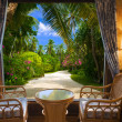 Hotel room and tropical landscape — Stockfoto