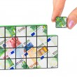 Hand and business puzzle — Stock Photo #4283539