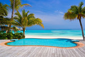 Pool on a tropical beach — Stock Photo