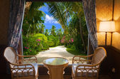 Hotel room and tropical landscape — Stock Photo