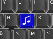 Computer keyboard with music key — Stock Photo