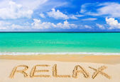 Word Relax on beach — Stock Photo
