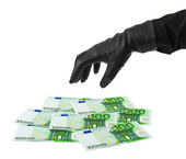 Hand in glove and money — Stock Photo