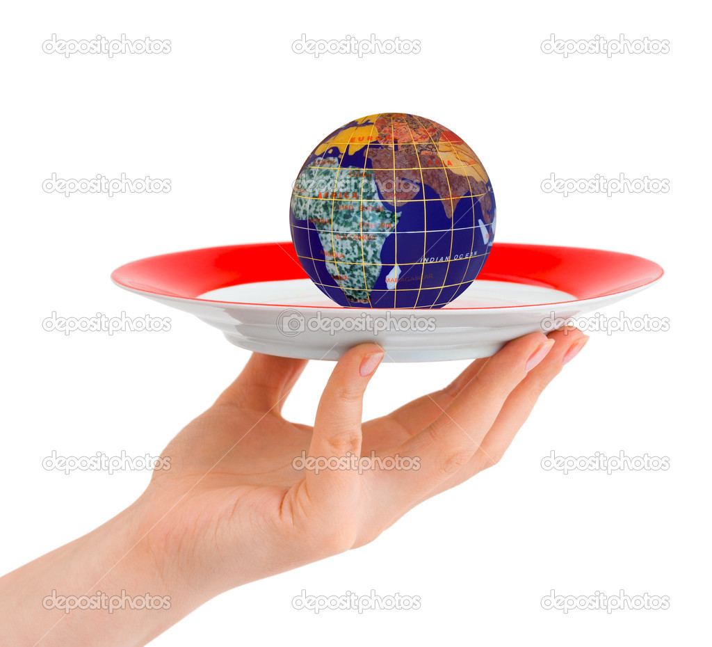 Hand with plate and globe isolated on white background  Stock Photo #4285271