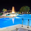 Water pool and fountain at night — Stock Photo #4305516