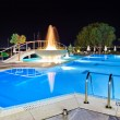 Stock Photo: Water pool and fountain at night