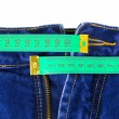 Stock Photo: Jeans and measuring tape