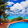 Pool in hotel at tropical beach — Stock Photo