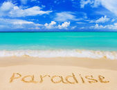 Word Paradise on beach — Stock Photo