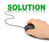 Hand with computer mouse and word Solution — Stock Photo