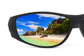 Sunglasses and seascape reflection — Stock Photo