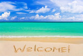 Word Welcome on beach — Stock Photo