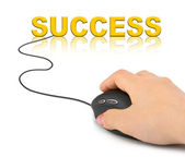 Hand with computer mouse and word Success — Stock Photo