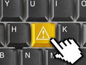 Teclado de la computadora con clave de atención — Foto de Stock