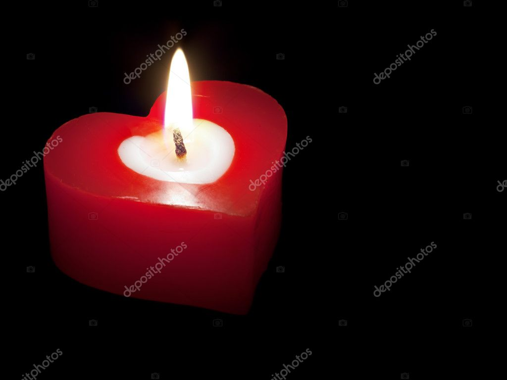Heart shaped candle isolated on black background — Stock Photo #4308354