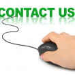 Hand with computer mouse and word contact us — Stock Photo