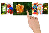 Hand scrolling christmas images — Stock Photo