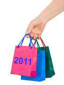 Hand with shopping bags 2011 — Stock Photo