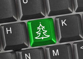 Computer keyboard with Christmas tree key — Stock Photo