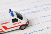 Toy ambulance car on ecg — Stock Photo