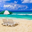 Chairs and umbrella at tropical beach — Stock Photo #4624697