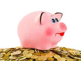 Piggy bank and heap of coins — Stock Photo