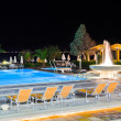 Water pool and fountain at night — Stock Photo