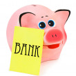 Piggy bank and note paper — Stock Photo