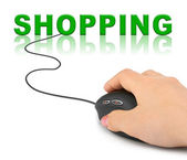 Hand with computer mouse and word Shopping — Stock Photo