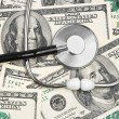 Stethoscope on money background — Stock Photo