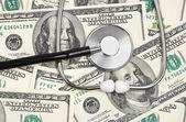 Stethoscope on money background — Stock Photo