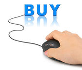 Hand with computer mouse and word Buy — Stock Photo