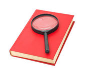 Magnifying glass and book — Stock Photo