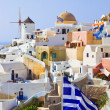 Santorini view (Oia) and greek flag — Foto de Stock