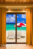 Hotel room and beach landscape — Stock Photo