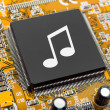 Stock Photo: Music note on computer chip
