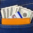 Money and credit card in jeans pocket — Stock Photo
