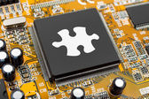 Puzzle on computer chip — Stock Photo