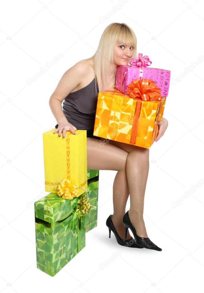 The young girl is surrounded by gifts in beautiful boxes — Stock Photo #2800299