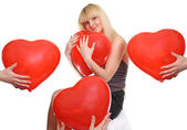 Girl presses to itself heart — Stock Photo