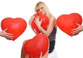 Girl presses to itself heart — Stock Photo