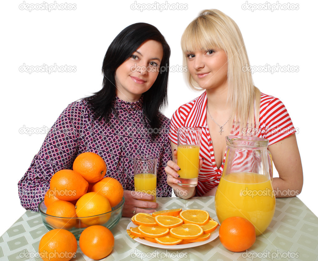 Two young women with fruit, a white background — Stock Photo #2811105