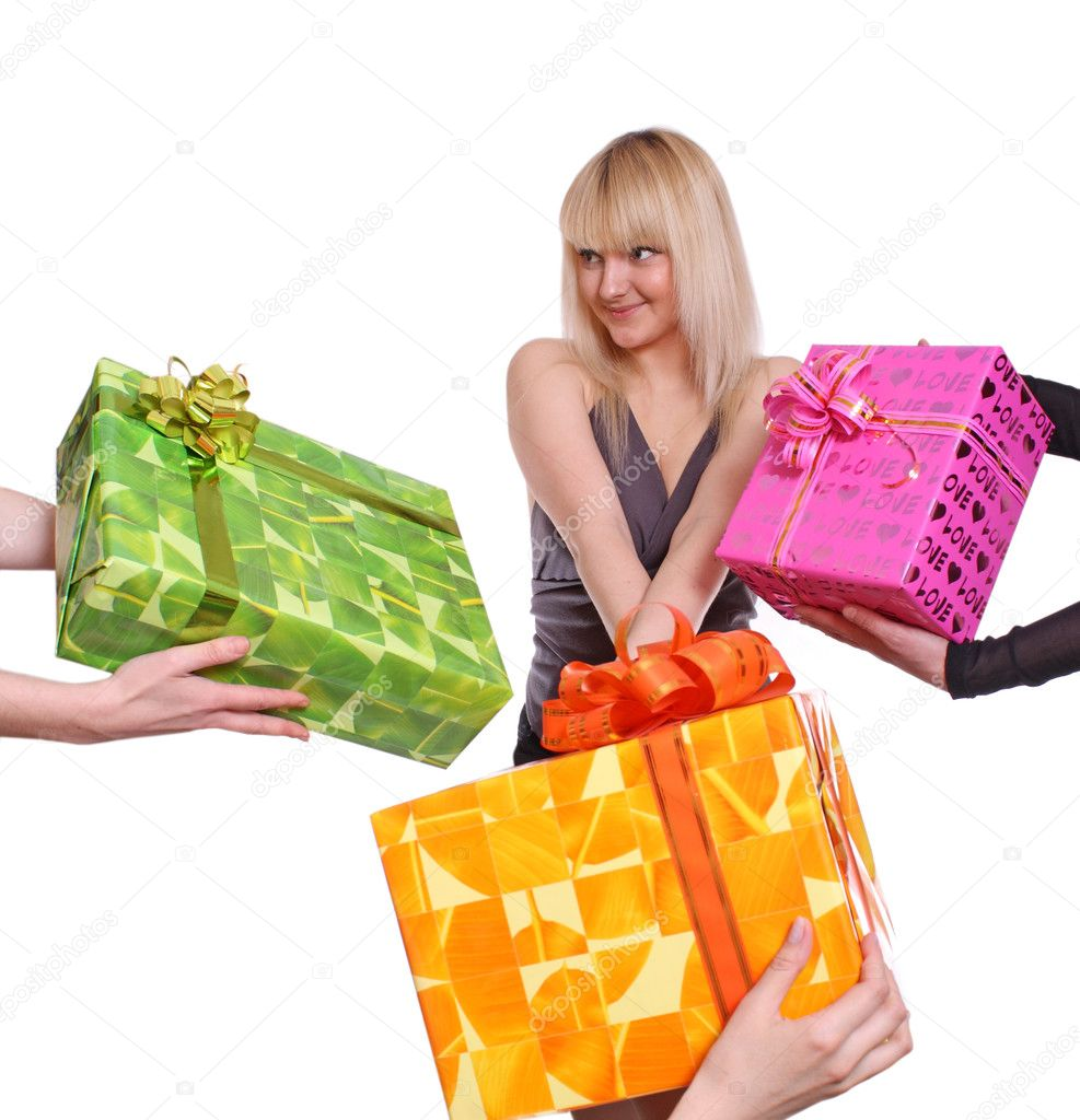 The young girl accepts gifts from different directions  Foto Stock #2811125