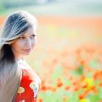 Girl in poppy field — Stock Photo #2755937