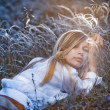 Romantic girl lying in grass — Stock Photo