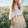 Young girl in field — Stock Photo