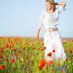 Slim woman in poppy field — Stock Photo #2756045