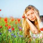 Girl in poppy field — Stock Photo #2756051