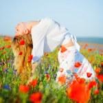 Girl posing in flower field — Stock Photo #2756061
